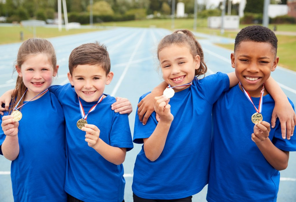 portrait-of-children-showing-off-winners-medals-on-sports-day.jpg